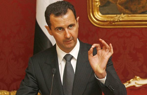 Syrian President Bashar al-Assad gives a