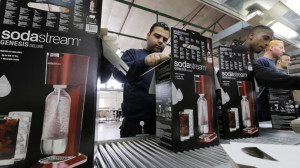 Employees pack boxes of the SodaStream product at the factory in the West Bank Jewish settlement of Maale Adumim