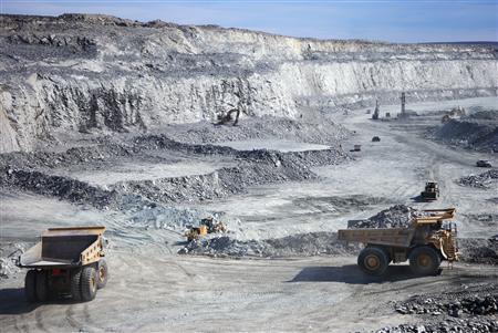 Hydraulic excavators scoop the broken rock into 100- or 150-tonne haul trucks at Agnico-Eagle's Meadowbank Mine in Nunavut, Canada