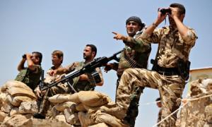Kurdish peshmerga fighters take position in Bashiqa, near Mosul.