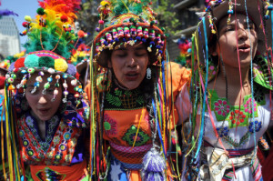 Mapuche girls marching at a political rally
