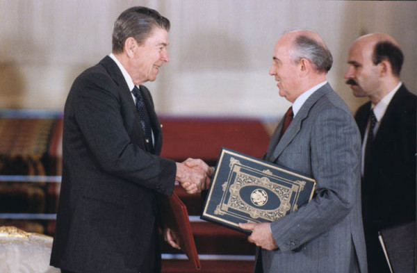 President_Reagan_and_Soviet_General_Secretary_Gorbachev_shake_hands_after_signing_the_INF_Treaty