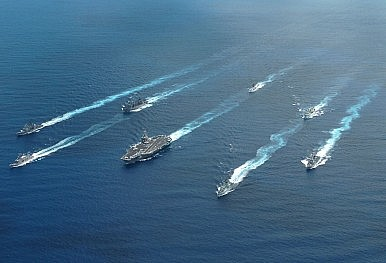 US_Navy_040625-N-9769P-245_Ships_from_the_United_States_and_Canada_navigate_around_the_aircraft_carrier_USS_John_C._Stennis_CVN_74_while_underway_in_the_Pacific_Ocean_during_a_multi-national_photo_exercise-386x263