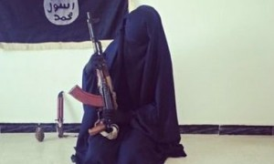 A female ISIS recruit poses with an AK-47.  (Source: The Guardian)