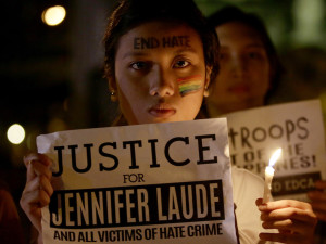 Protestors light candles and demand justice in the murder of Filipino transgender woman Jennifer Laude. (AP Photo/Bullit Marquez)