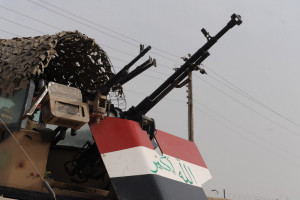 An Iraqi soldier of the 9th Iraqi Army Division (Mechanized) pulls security from his turret outside of an election site in Solmon Pak, Iraq, Jan. 30, 2009.   (U.S. Army photo by Spc. Chase Kincaid/Released)