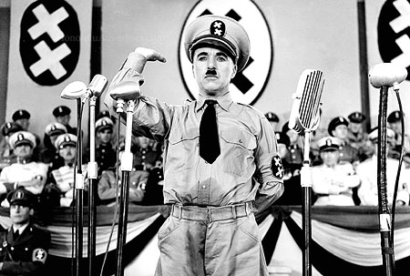 "085007_1.tif. ** FILE **Legendary silent film actor/director Charlie Chaplin is shown in a scene from the 1940 film ""The Great Dictator,"" his first film with dialogue, in this promotional photo. Chaplin plays the dual roles of a sweet-natured Jewish barber and a murderous Hitler-type dictator. Four of Chaplin's films ""The Gold Rush,"" ""The Great Dictator,"" ""Modern Times,"" and ""Limelight,"" are being released on DVD July 1, 2003, from Warner Home Video, as the first in a series of ten titles included in ""The Chaplin Collection."" (AP Photo/The Roy Export Company Establishment, HO)"