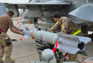 RCAF ground crew mount munitions on CF-188 Fighter jet prior combat mission over IRAQ