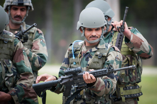 An_Indian_Army_paratrooper_with_the_50th_Independent_Para_Brigade_examines_an_M4_carbine_prior_to_sighting_in_the_weapon_at_Fort_Bragg,_N.C.