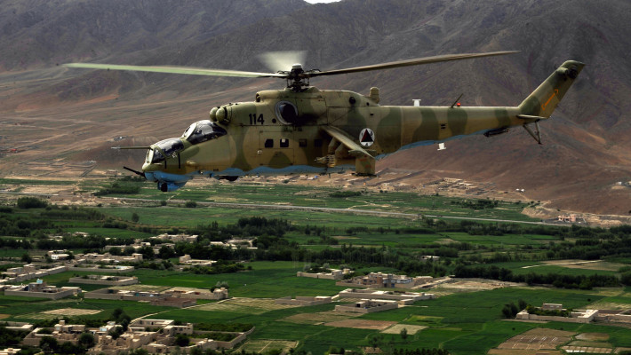 "A photo taken from inside an MI-35 Hind E helicopter of another Afghan National Army Air Corps Mi-35 piloted by Hungarian Air Force Maj. Bela Lazar, Hungarian Operational Mentoring Liaison Team commander, and Afghan National Army Air Corps Capt. Gholar Mohaiudin, May 11, 2010, over Afghanistan. ""I have a solid mind to be a good pilot, but our advisors have showed us the organizational skills it takes to execute our mission in combat,"" said Capt. Mohaiudin, who has more than 22 years of experience flying the airframe. ""Teaching us to defend our friends in battle and serve our country is something I will always appreciate, we are an asset for the Afghan people and we can be an active part in the defense of our nation."" (U.S. Air Force photo/ Staff Sgt. Manuel J. Martinez/released)"