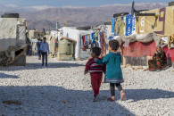 Two Syrian children walk through the Dalhamiye informal settlement for Syrian refugees in Lebanon on December 15, 2015. Photo: Corporal Mathieu Gaudreault, Canadian Forces Combat Camera IS21-2015-0041-011 ~ Deux enfants syriens se promènent dans le camp de réfugiés syriens à Dalhamiye, au Liban, le 15 décembre 2015. Photo : Caporal Mathieu Gaudreault, Caméra de combat des Forces canadiennes, MDN IS21-2015-0041-011